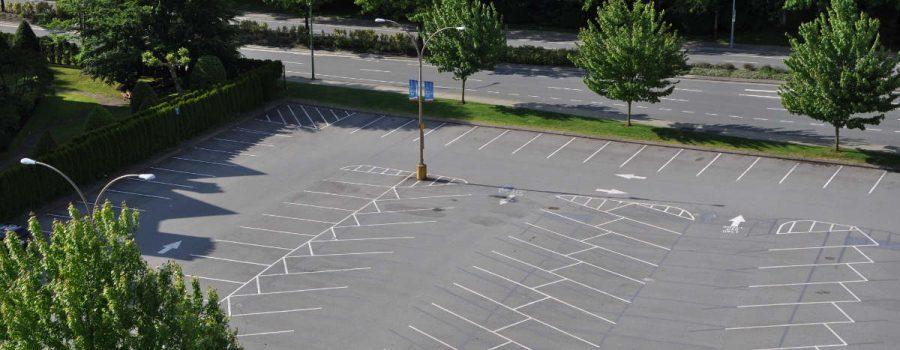 Aerial shot of an empty parking lot in Houston which was recently paved by PavingRite Construction - Parking Lot Paving Services Houston TX - PavingRite Construction