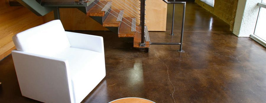 Indoor shot of a beautifully stained concrete floor inside a luxury home in Houston TX - Concrete Staining Services Houston TX - PavingRite Construction