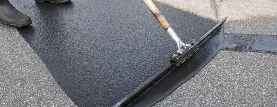 Closeup of a Houston asphalt driveway undergoing a sealcoating job - Asphalt Sealcoating Services Houston TX - PavingRite Construction